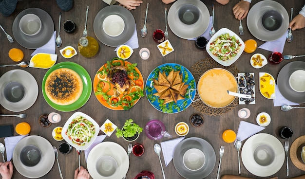 Table of enjoying food with family and friends top view