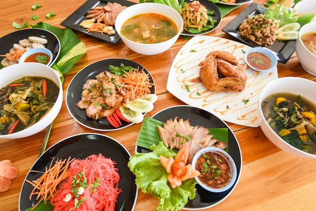 Table food served on plate tradition northeast food isaan delicious on plate with fresh vegetables many variety various thai menu asian food