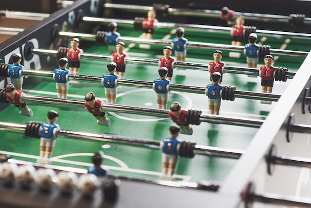 Table football in the entertainment center. close-up image of plastic players in a football game