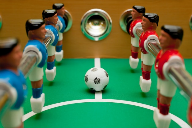 Table football players, close-up with the ball.
