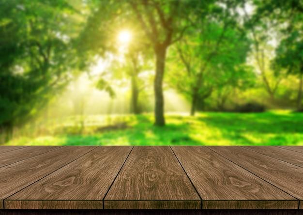 제품 표시를 위해 테이블에 빈 복사본 공간이있는 녹색 흐림 자연의 테이블