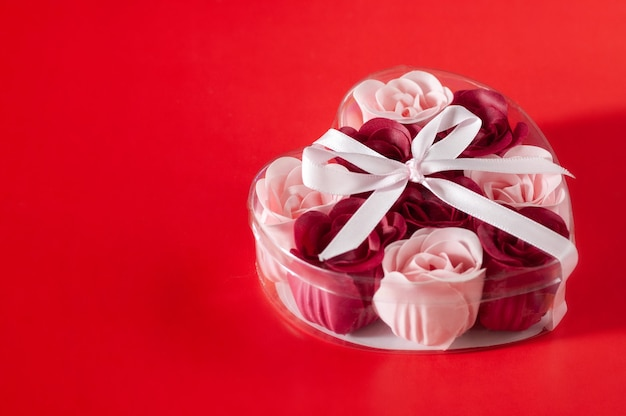 On the table is a gift set of soap. valentine's day