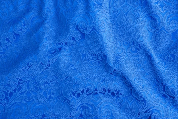 Table is made of blue textile material abstract tapestry drawing, the texture of a piece of clothing.