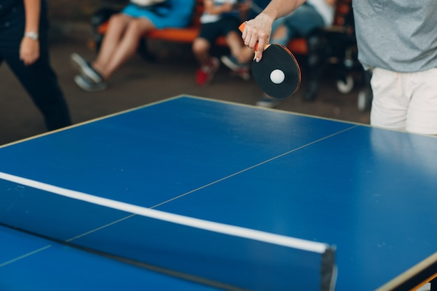 Table for ping pong and player with racket