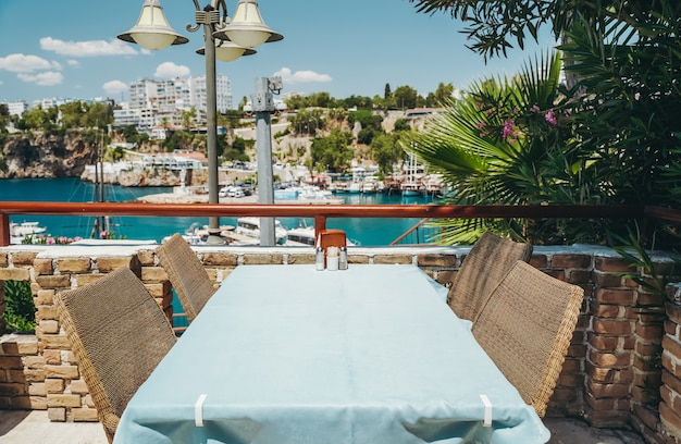 A table in a restaurant or a summer cafe on the sea coast of antalya turkey place in a restaurant wi...
