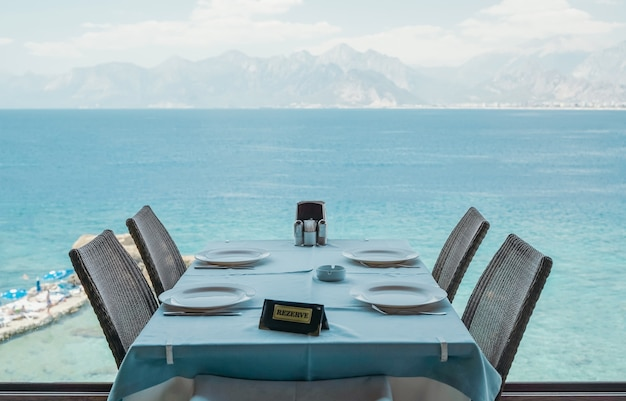 A table in a restaurant or a summer cafe on the sea coast of antalya turkey place in a restaurant
