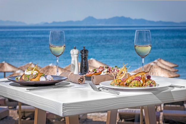 Table in the restaurant with mediteranina food near the sea