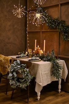 Table served for christmas dinner, festive setting with decorations