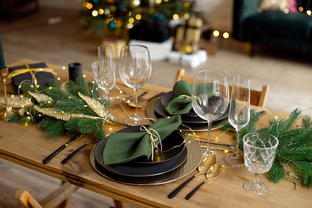 Table served for christmas dinner in living room, close-up view, table setting, christmas decoration