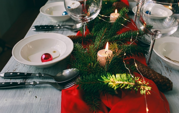 Table served for christmas dinner in living room.  close up view, table setting. winter decorations.