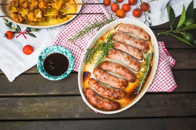 Table served with grilled meat and sausages