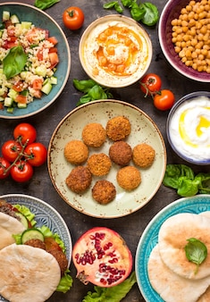 Table served with middle eastern traditional dishes. bowl with falafel, doner kebap, hummus