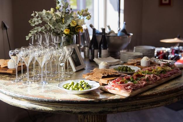 Table set glasses of champagne olives jamon