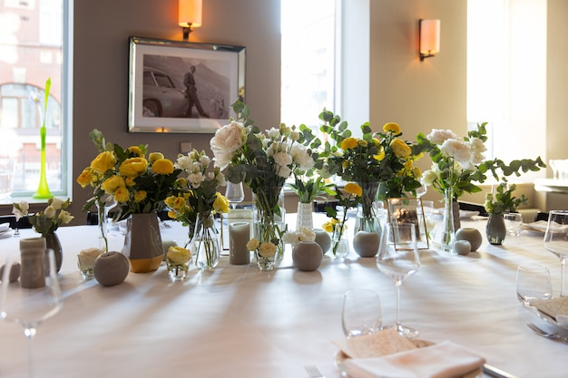 Table set with yellow roses for a festive party