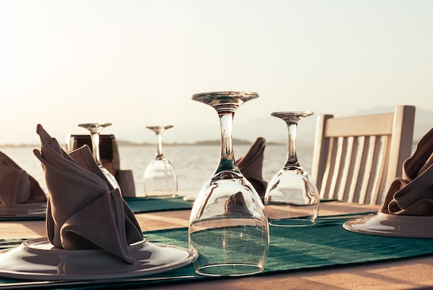Table setting at beach restaurant at sunset