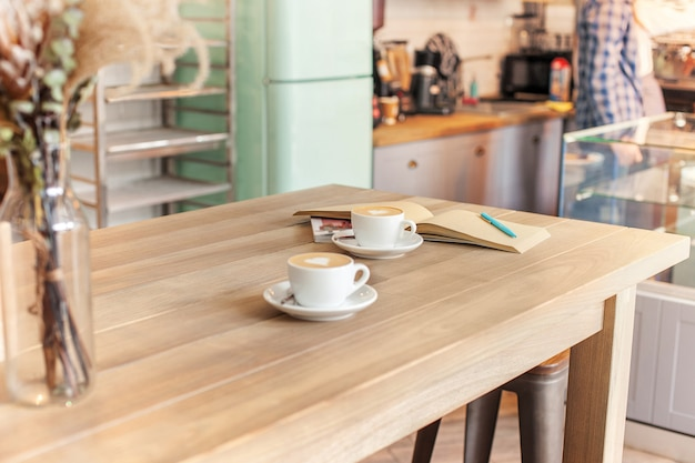 A table setting for coffee on the counter at a coffee house