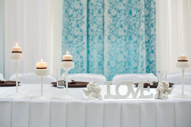 Table setting for a holiday with the letters love
