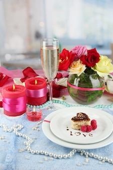 Table setting in honor of valentine's day on room space