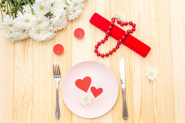 Table setting, love hearts, gift and flowers