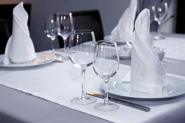 The table setting in restaurant close up. tableware for drinks and food
