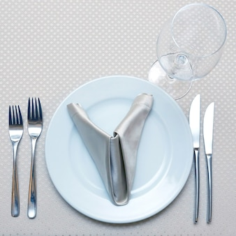 The table setting in restaurant closeup. tableware
