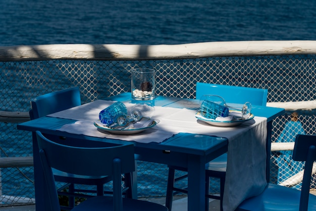 Table setting on restaurant patio at waterfront, anacapri, capri, campania, italy