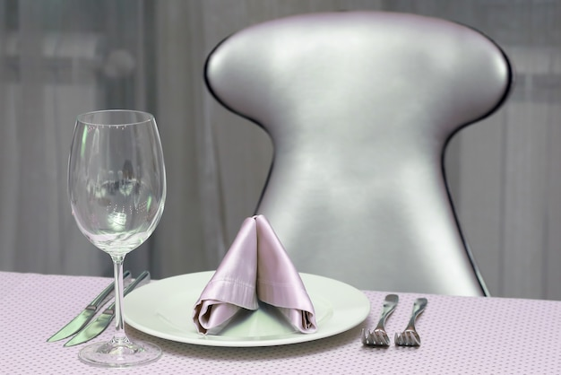 The table setting in restaurant. tableware for drinks and food