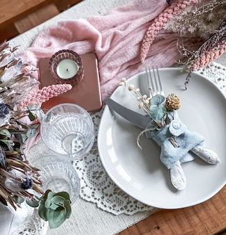 Table setting for a romantic dinner, wedding or any occasion with candles and dried flowers as decor.