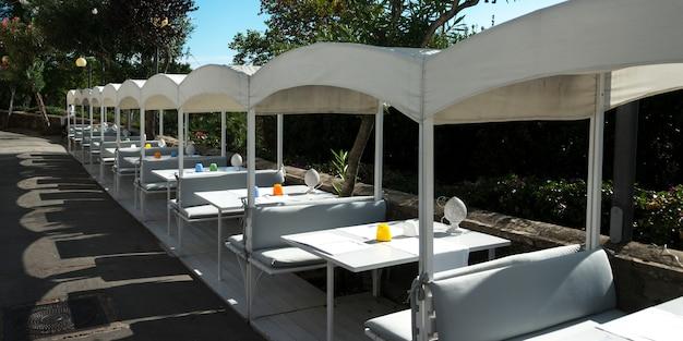 Table setting at sidewalk cafe, capri, campania, italy