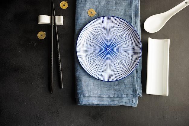 Table setting with chopsticks Premium Photo
