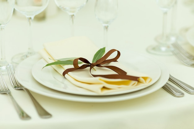 Table setting with fresh flowers in brown tones