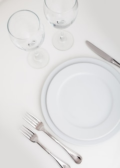 Table setting with plate, forks, knife and glasses