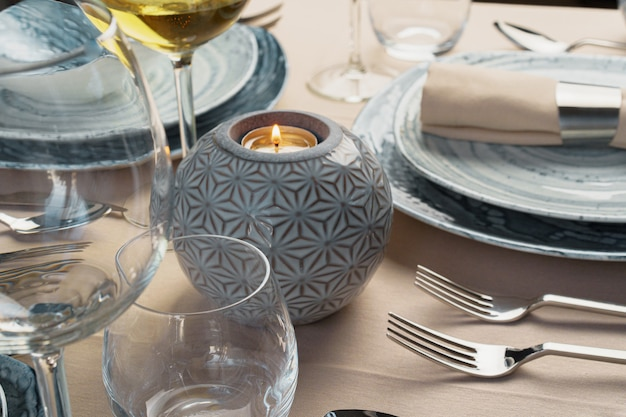 Table setting with stylish dishware on beige tablecloth