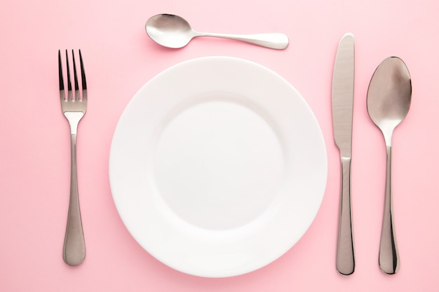 Table setting with white plates, and cutlery