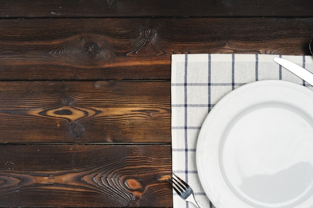 Table setup with plates on dark wooden table