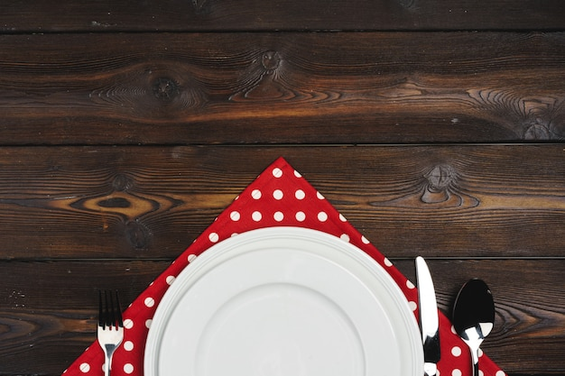 Table setup with plates on dark wooden