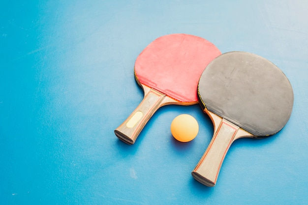Table tennis equipment on blue table