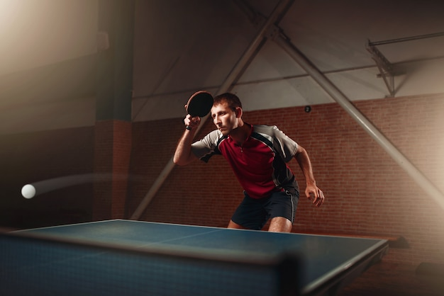 Table tennis, player in action, ball with trace