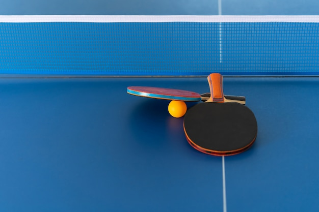 Table tennis racket and ball, indoor sport activity