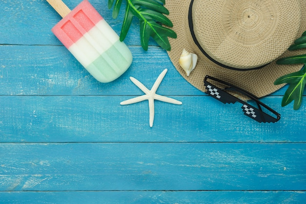 Table top view accessory of clothing women  plan to travel in summer holiday background.