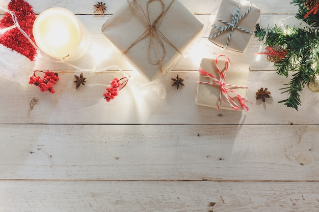 Table top view of the merry christmas & happy new year concept background.essential festive decorations on modern brown wood.copy space for creative  text or wording.design mock up and template.