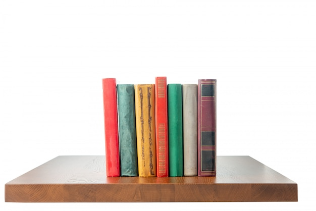 Table top with books on white isolated space