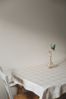Table with bouquet of flowers and chairs