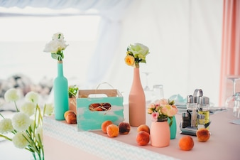 Table with decorative bottles and fruit