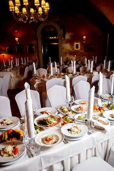 Table with food before the banquet. ready for guests hall.