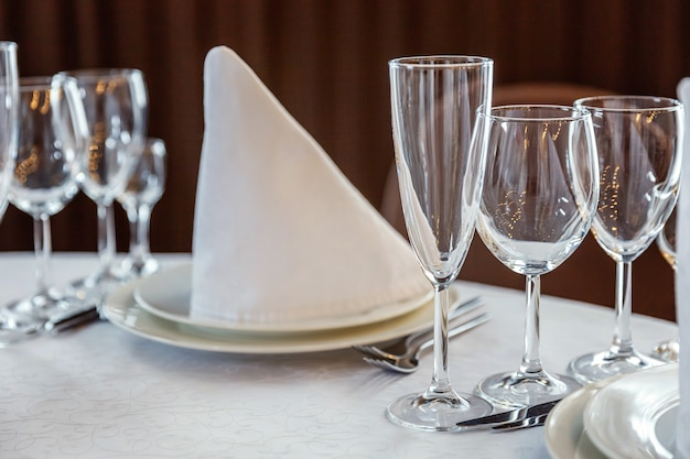 Table with glasses and napkins served for dinner in restaurant