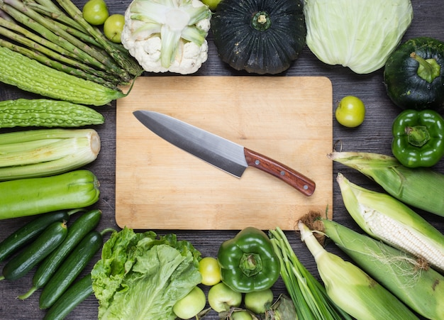 Table with green vegetables and knife