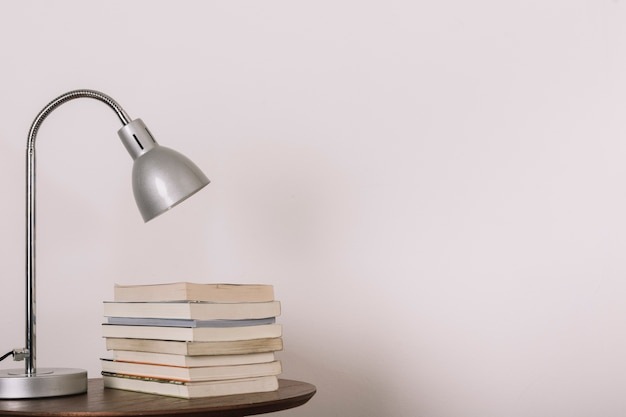 Table with lamp and books
