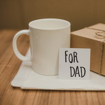 Table with mug and gift for father's day