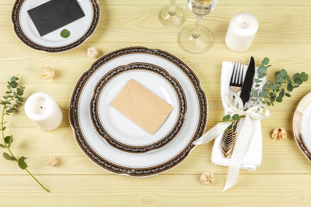Table with plates and cutlery, view from above